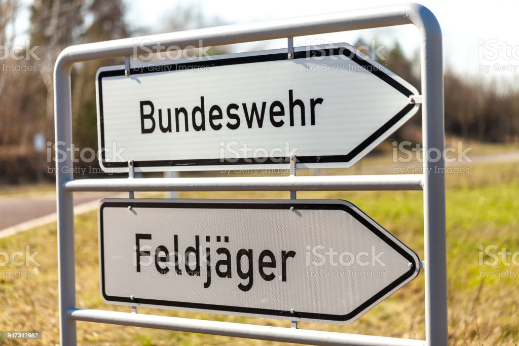 german Bundeswehr and Feldjaeger sign near a barrack. Bundeswehr means German armed forces and Feldjaeger is the german word for military police stock photo