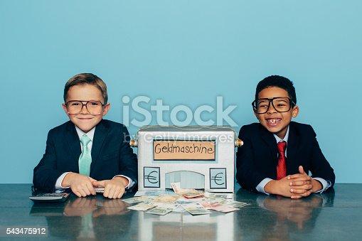 844638658 istock photo German Business Boys Make Euros with Homemade Money Machine 543475912