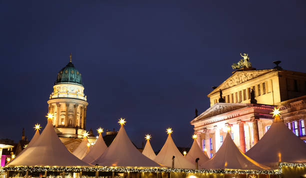 German Church in and Concert Hall Gendarmenmarkt, Berlin, Germany German Church, Concert Hall and Gendarmenmarkt Christmas Market in Gendarmenmarkt Square, Berlin City, Germany gendarmenmarkt stock pictures, royalty-free photos & images