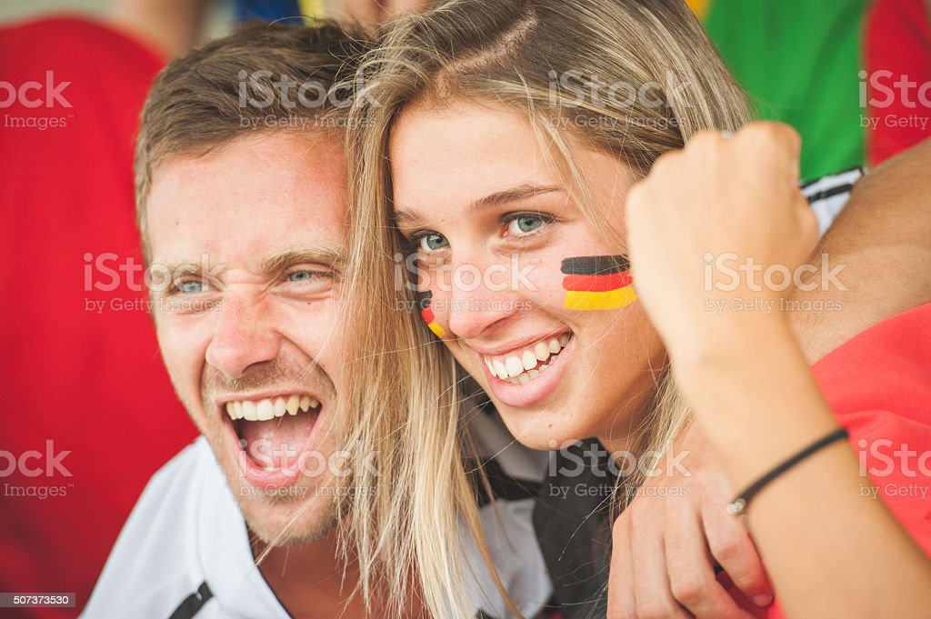 German Couple at Stadium stock photo