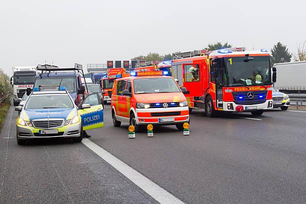 german emergency service cars stands on freeway a2 - feuerwehrmann deutsch stock-fotos und bilder