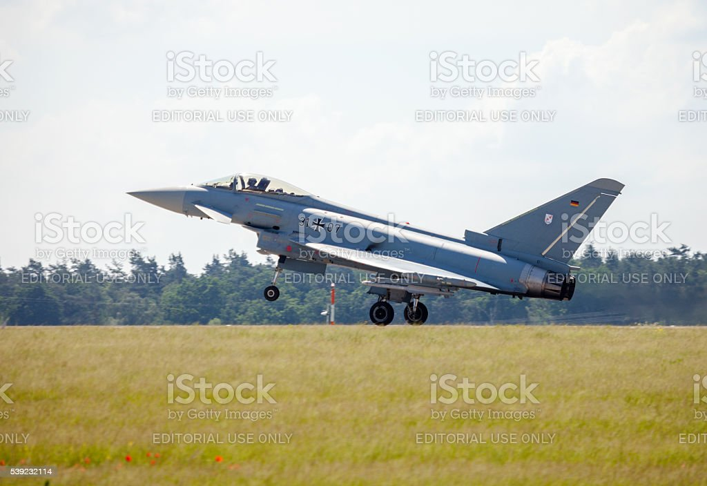 german eurofighter typhoon lands on airport royalty-free stock photo