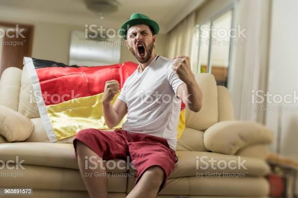 German Fan Celebrating At Home - Fotografias de stock e mais imagens de Adulto