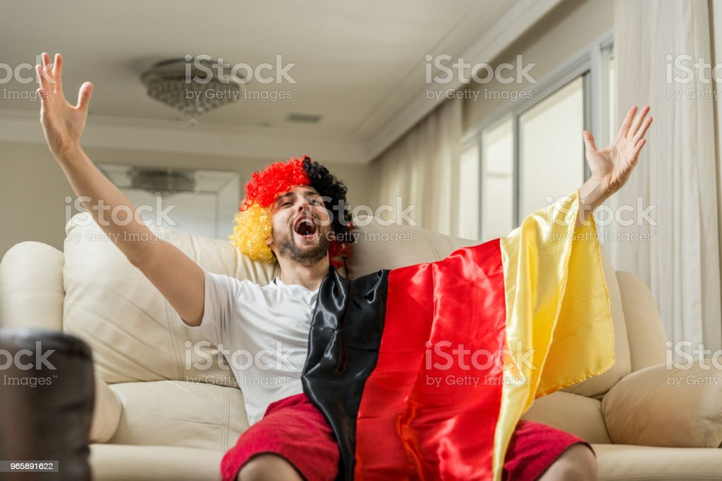 German fan celebrating at home - Royalty-free Adult Stock Photo