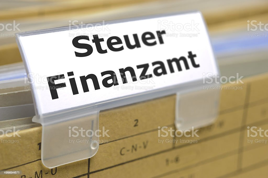 german file folder marked with Finanzamt - tax office stock photo