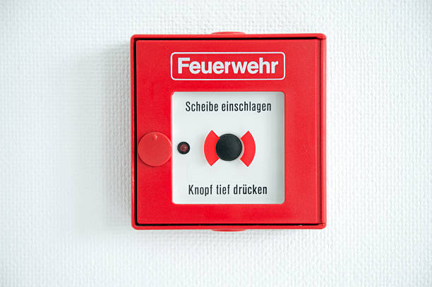 German fire alarm box on a wall stock photo