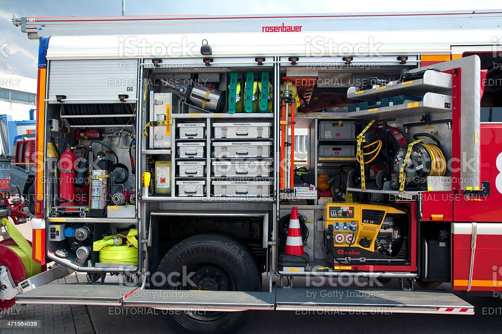Parked and opened german fire truck so that the numerous equipment is...