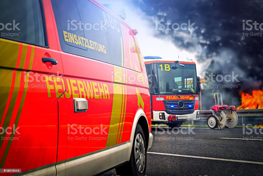 German firefighting trucks stands on a fire bildbanksfoto