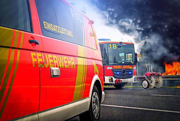 german firefighting trucks stands on a fire - feuerwehrmann deutsch stock-fotos und bilder