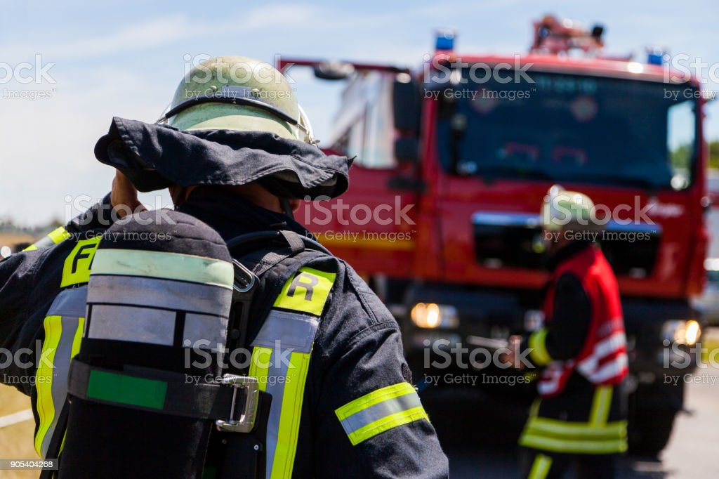 german fireman ( Feuerwehr ) stands near an accident stock photo