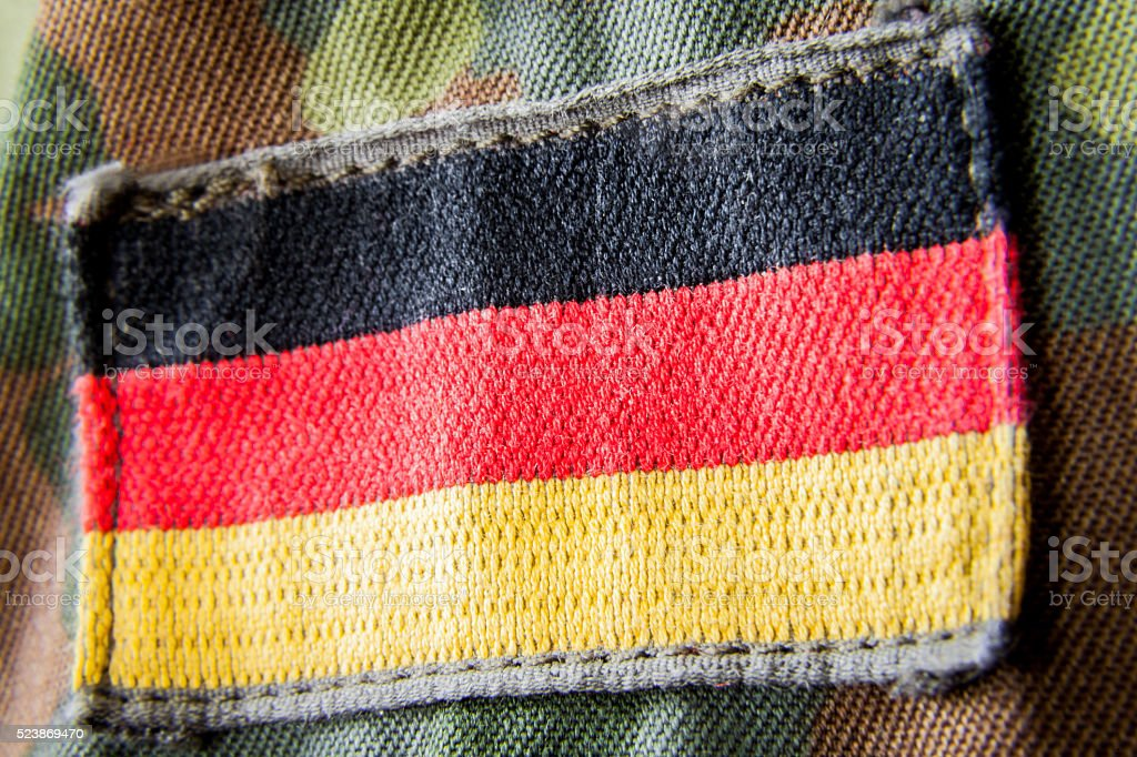 german flag appliquéd on military jacket stock photo