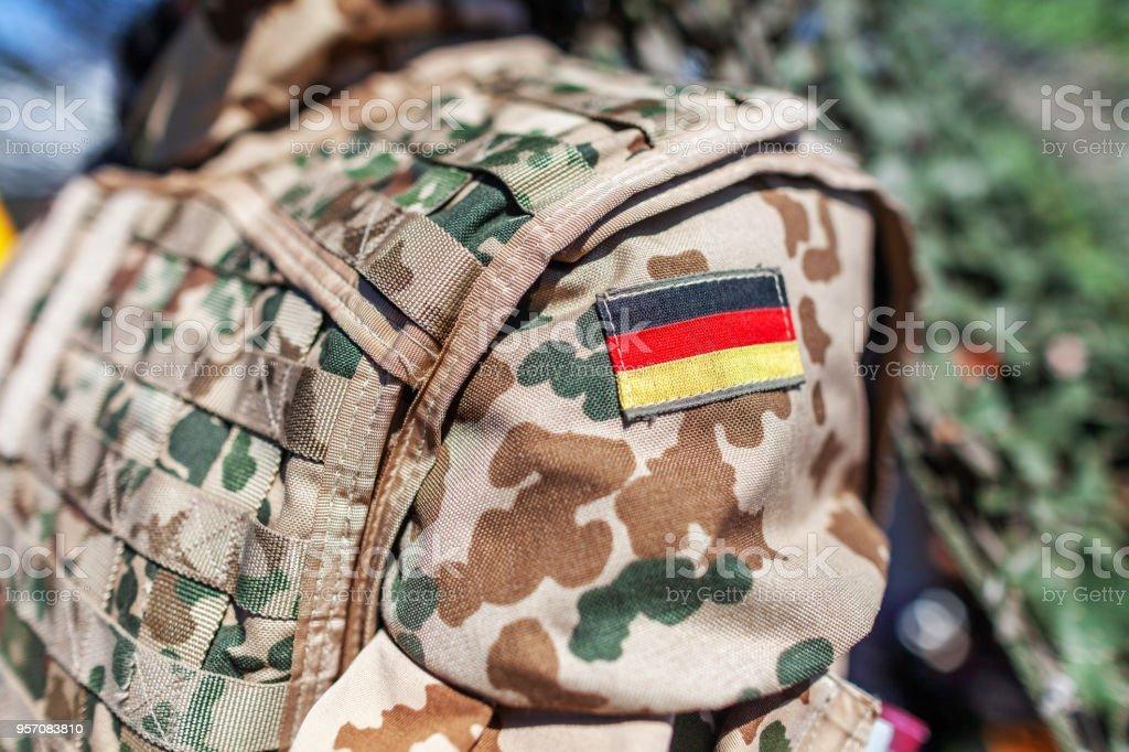german flag on a german soldier desert uniform stock photo