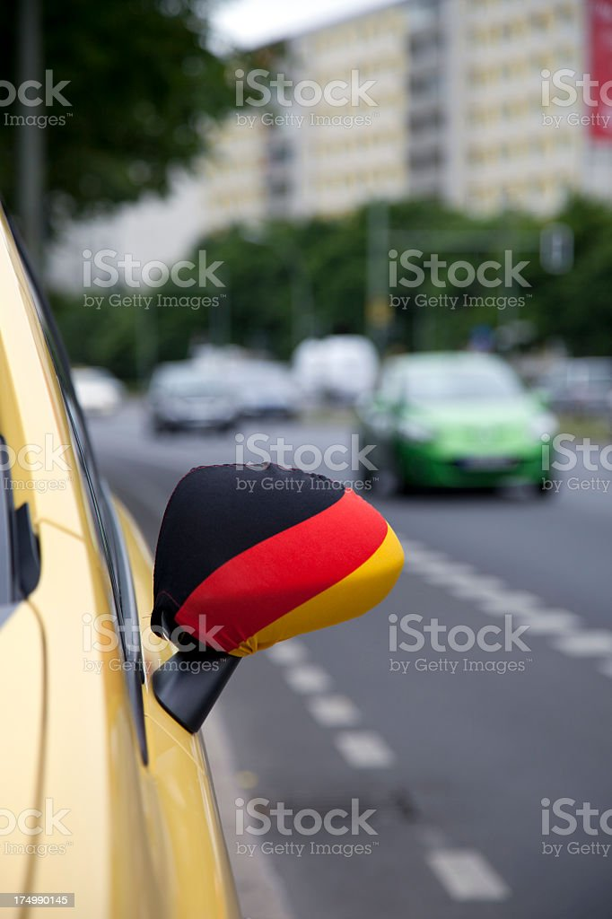 German flag on car wing mirror royalty-free stock photo