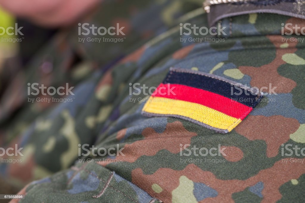 german flag on german army uniform stock photo