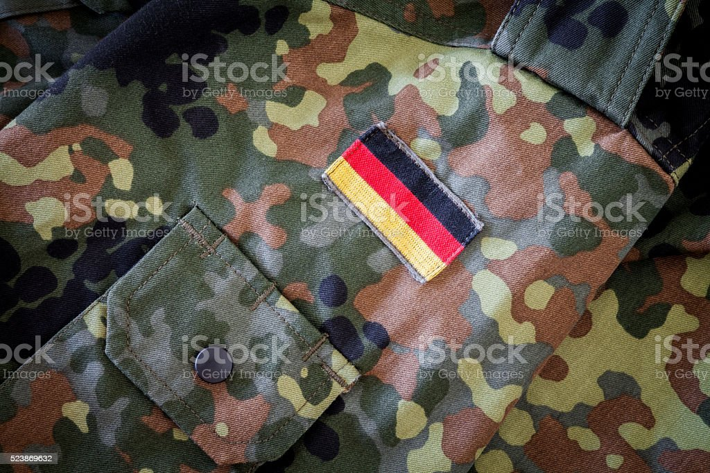 german flag on german military jacket stock photo