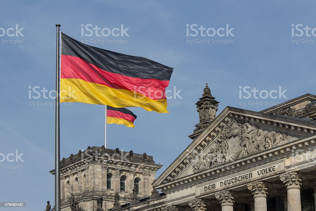 German flag on parliametn building ( Reichstag), berlin, germany stock photo