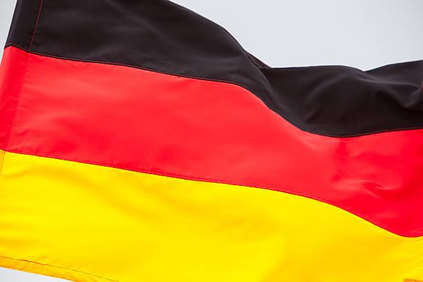 German flag waving on the sky stock photo