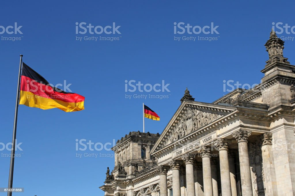 German flags and Reichstag building in Berlin, Germany stock photo