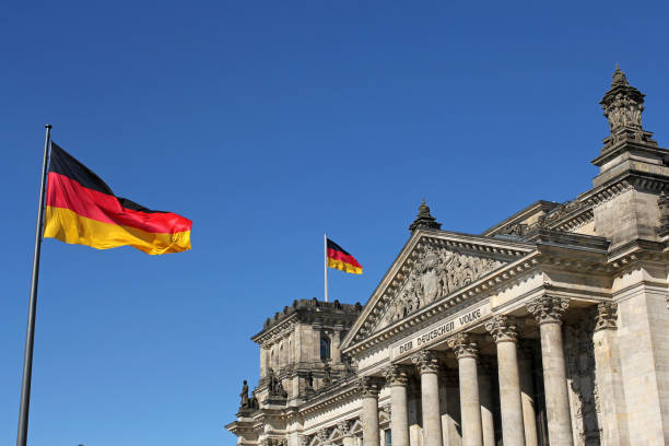 German flags and Reichstag building in Berlin, Germany - foto stock