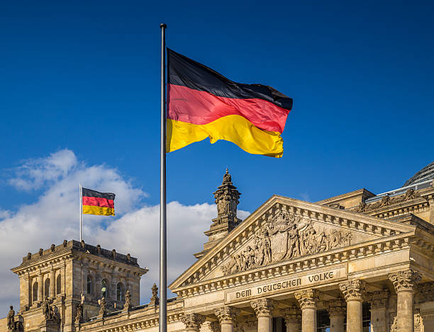 german flags at reichstag, berlin, germany - tysk kultur bildbanksfoton och bilder