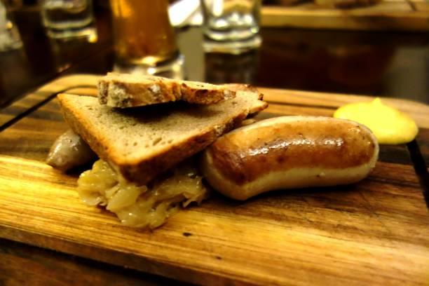 German Food - Sausage with Sauerkraut, Bread and Mustard stock photo