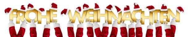 alman frohe weihnachten mutlu noeller noel baba eller altın harfler - weihnachten stok fotoğraflar ve resimler