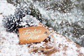 istock german 'Frohes Fest' (merry christmas) on tag in the snow 501251378