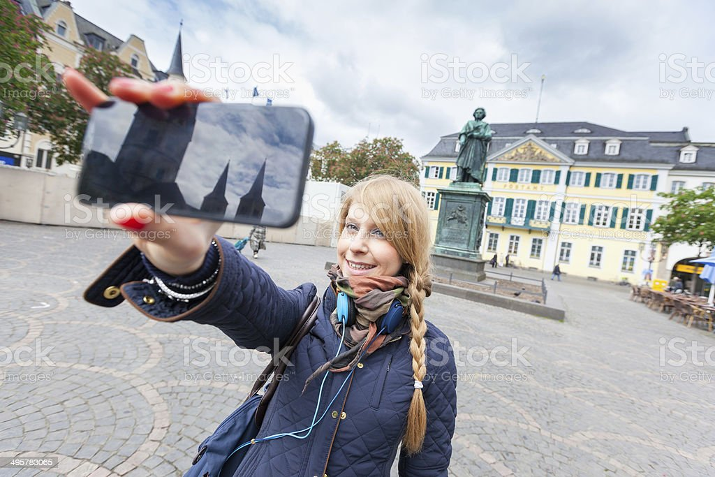 German Girl Taking Selfie in Bonn Main Square stock photo