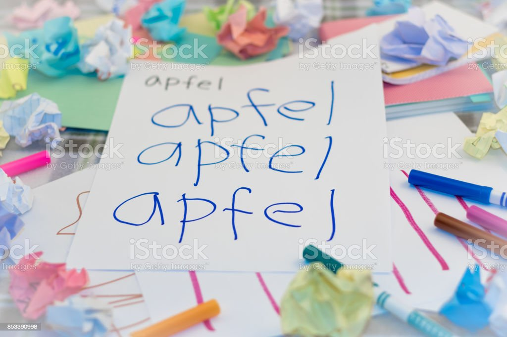 German; Kids Writing Name of the Fruits for Practice (Translation; Apple) stock photo