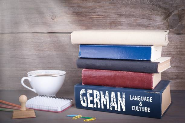 German language and culture concept German language and culture concept. Stack of books on wooden desk german culture stock pictures, royalty-free photos & images