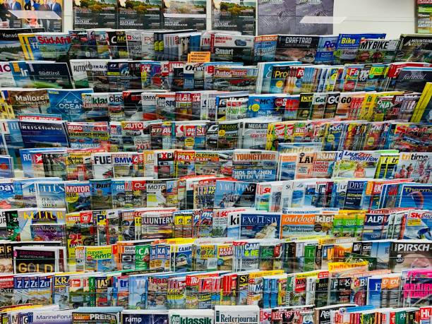 German magazines in a store shelf - October 2018 German magazines in a store shelf - October 2018 news stand stock pictures, royalty-free photos & images