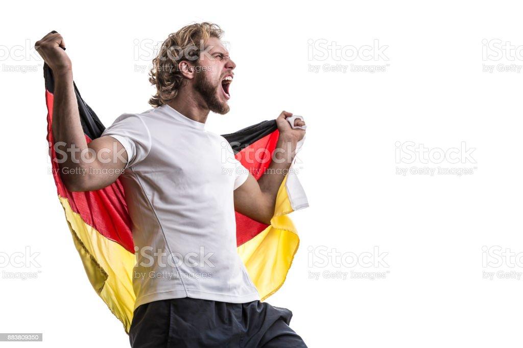 Atleta masculina alemão / ventilador comemorando em fundo branco - foto de acervo