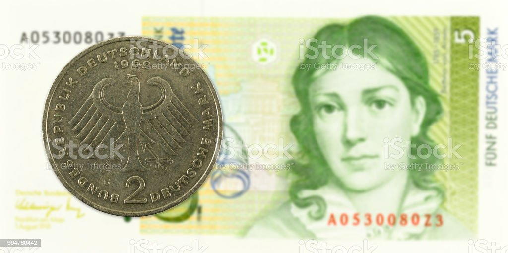 2 german mark coin agains 5 german mark bank note royalty-free stock photo