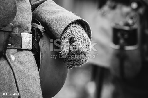 1061204700 istock photo German Military Ammunition Of A German Soldier At World War II. Warm Autumn Clothes, Soldier's Overcoat, Gloves, Helmet. Photo In Black And White Colors. 1061204690
