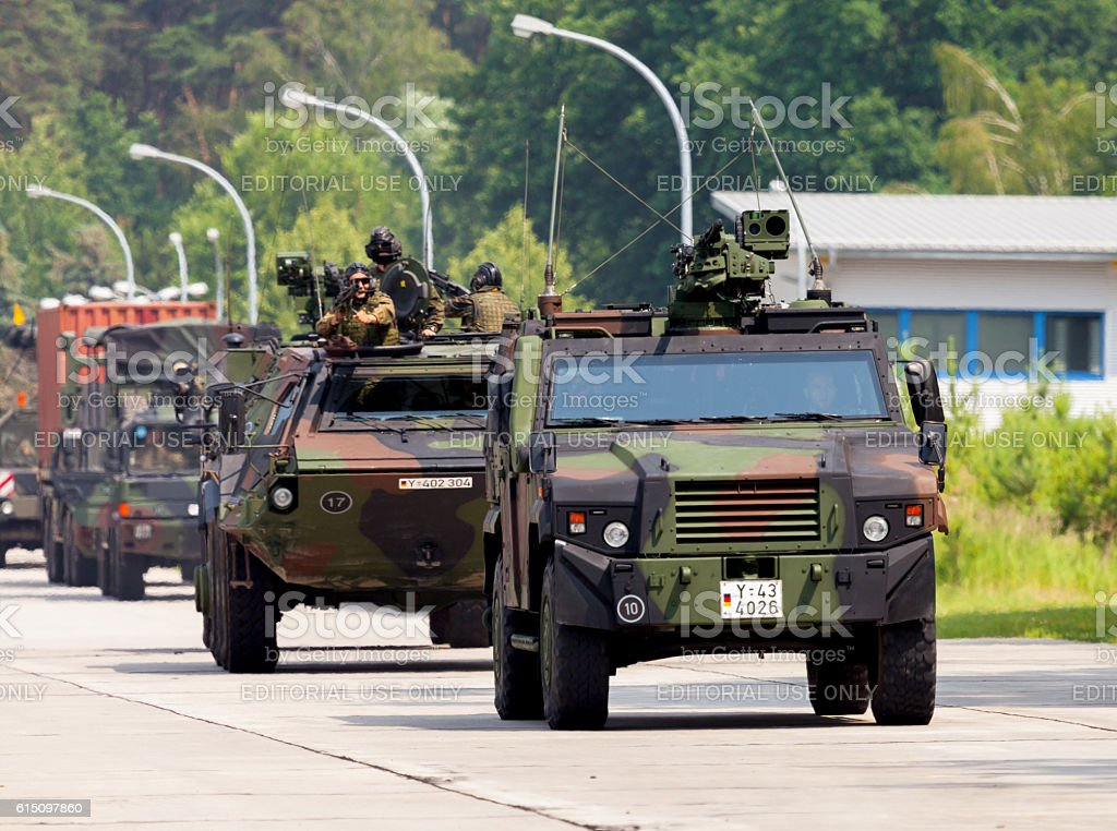german military army convoy, drives on a street stock photo