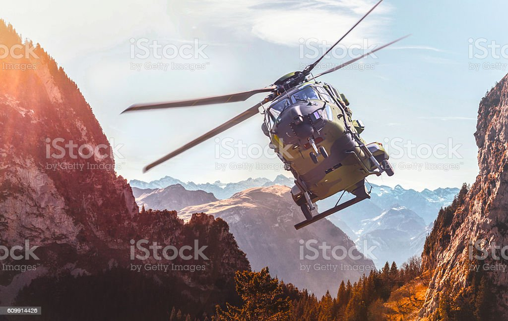 german military helicopter in flight stock photo