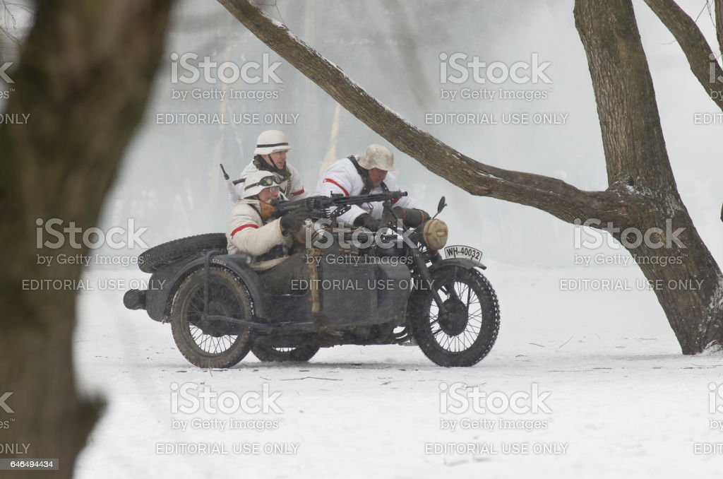 German motorcyclists armed with a machine gun MG42 stock photo