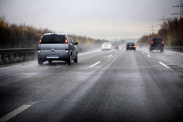 """German motorway, bad weather conditions """"German motorway on a rainy day, bad weather conditions - Photography has been taken during driving, some motion blur"""" slippery stock pictures, royalty-free photos & images"""