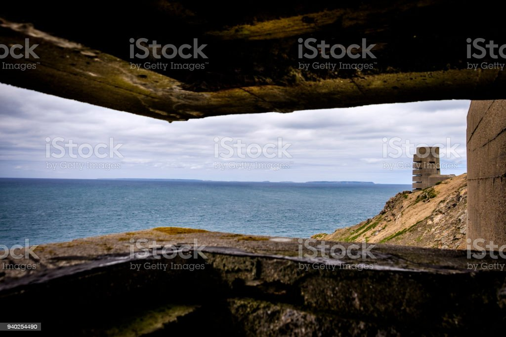 WWII German Naval Tower MP3, Battery Moltke, viewed from bunker, St Ouen, Jersey, Channel Islands. Guernsey Sark and Herm vissible on the horizon. stock photo
