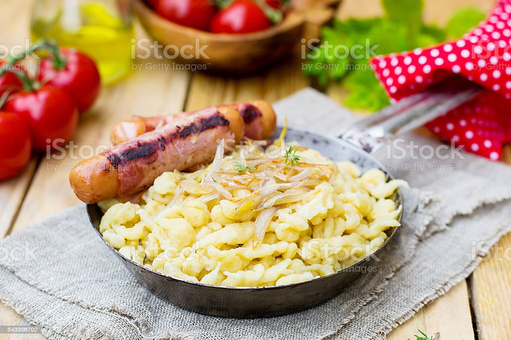 German noodles Spatzle with fried onions and sausages stock photo