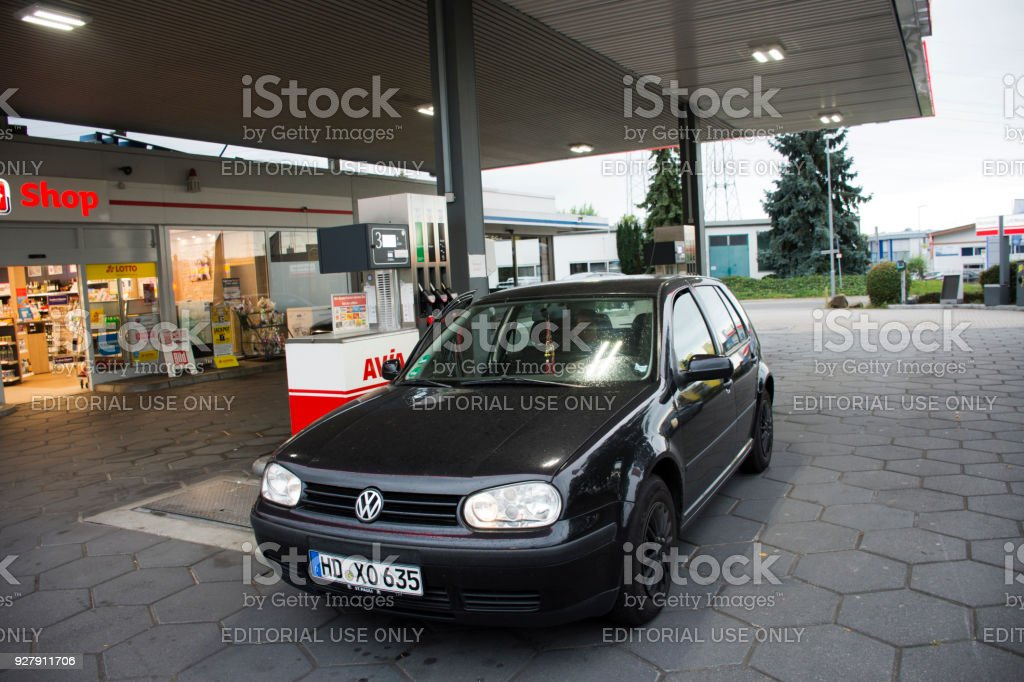 German old men people drive car go to fill oil in petrol station stock photo