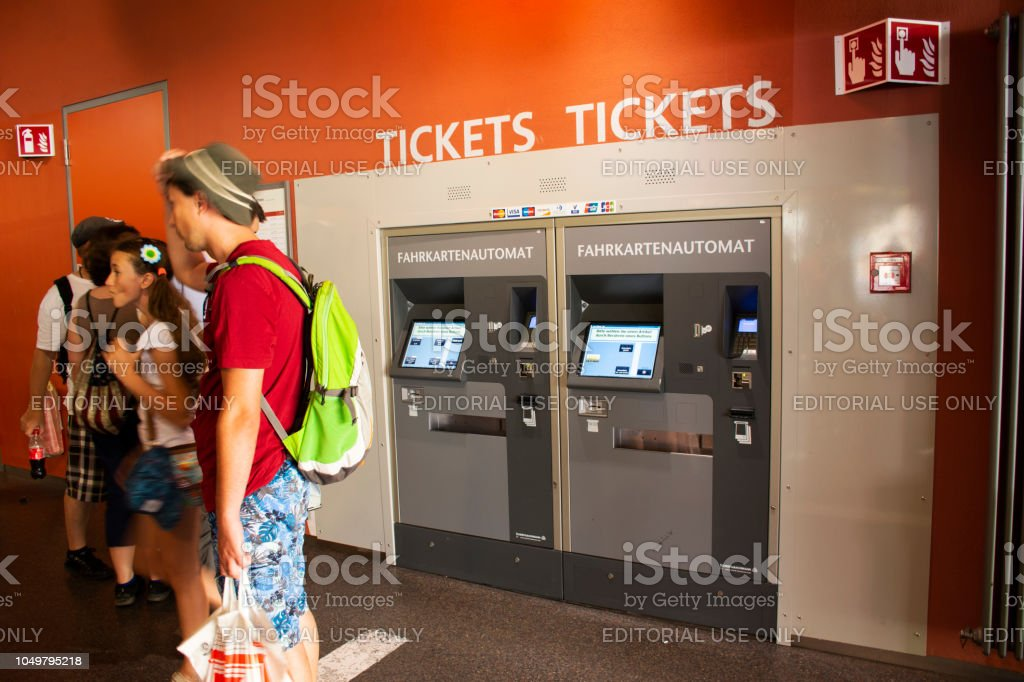 German people and foreigner travelers buy ticket of tram from automatic sale ticket box stock photo