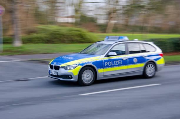 German police car drives on a street. stock photo