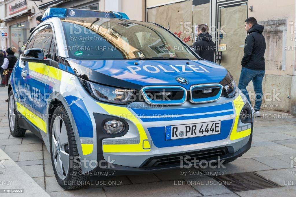 German Police car on the Neupfarrplatz at carnival parade in Regensburg stock photo