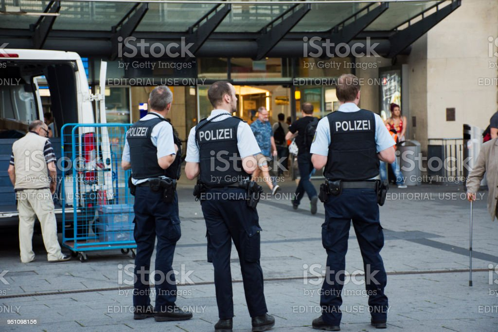 German police men standing security for people stock photo