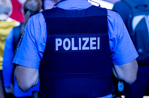 Frankfurt, Germany - February 25, 2020: Police officer during street carnival in Frankfurt-Heddernheim, Germany. In response to terrorist attacks in germany, police presence was increased during the carnival days