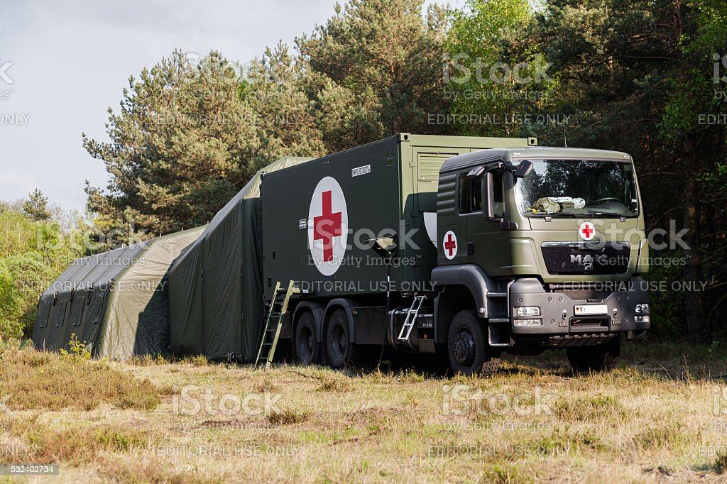 german rescue center system on trucks stands in a wood stock photo