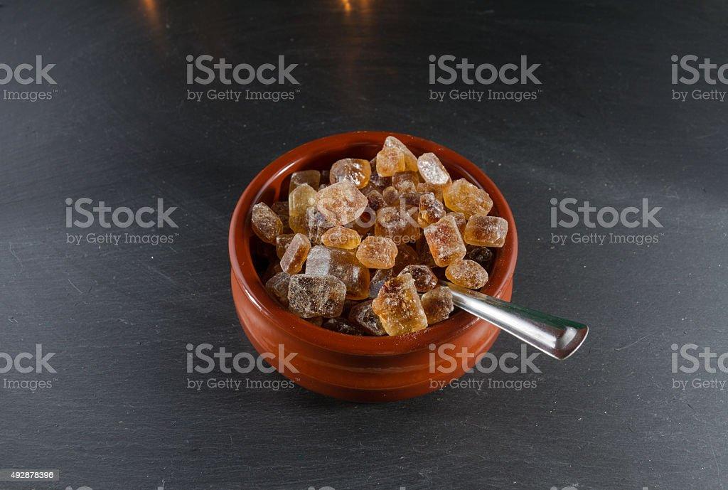 German rock sugar Brauner Kandis bowl spoon stock photo