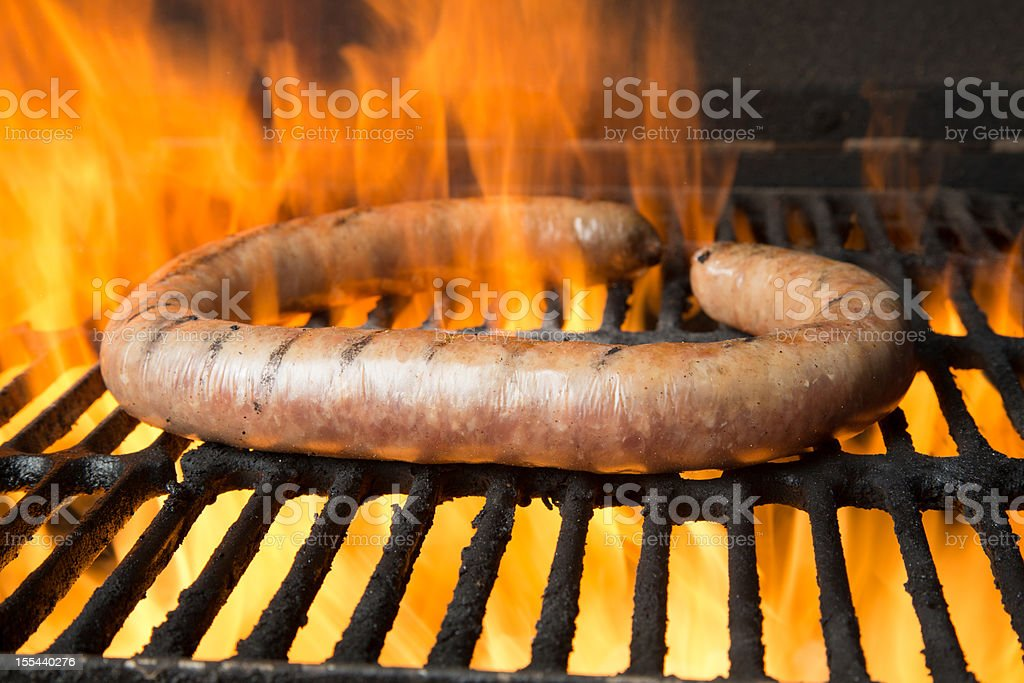 German Sausage on Grill with Flames royalty-free stock photo