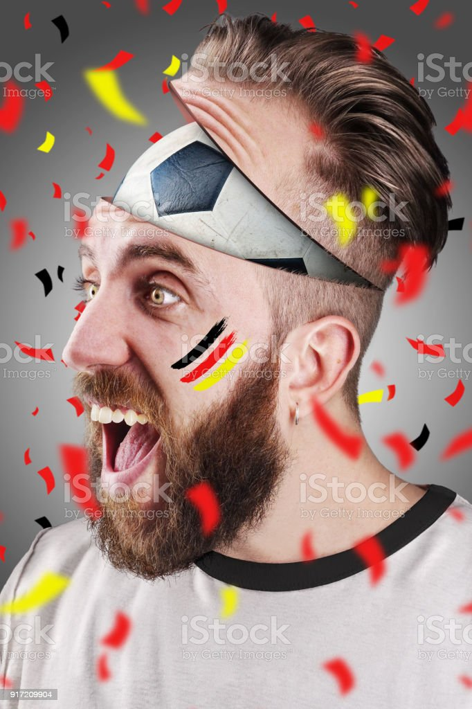 German soccer fan with football inside the head stock photo